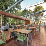 A modern restaurant terrace in the summer with matching restaurant furniture design